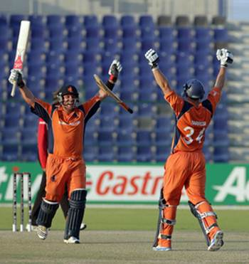 Michael Swart (left) and Wesley Barresi of the Netherlands celebrate after defeating Scotland