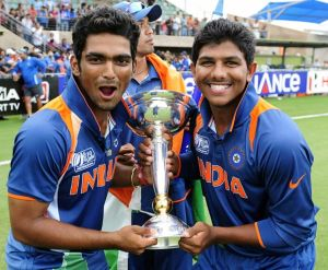 Vijay Zol (left) and Akhil Herwadkar celebrate with the trophy after India's triumph in the 2012 ICC Under-19 Cricket World Cup
