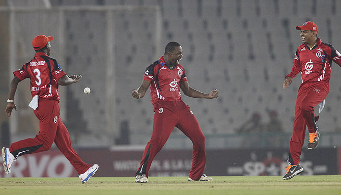 Navin Stewart of Trinidad&Tobago celebrates a wicket