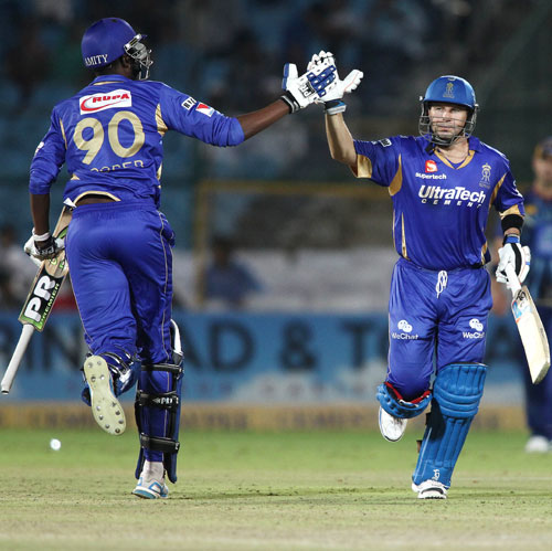 Kevon Cooper of Rajasthan Royals and Brad Hodge of Rajasthan Royals celebrate after beating Otago Volts