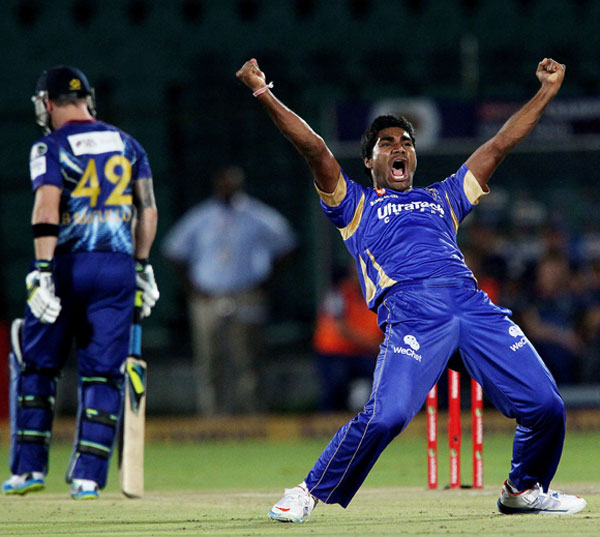 Rahul Shukla of Rajasthan Royals celebrates the wicket of Hamish Rutherford of Otago Volts