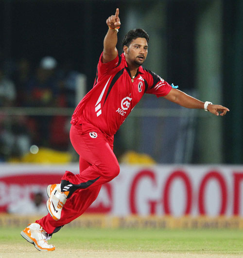 Ravindarnath Rampaul of Trinidad and Tobago celebrates the wicket of Michael Hussey of Chennai Super Kings
