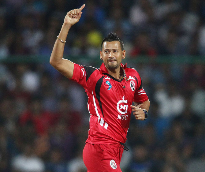 Rayad Emrit of Trinidad and Tobago celebrates getting Chennai Super Kings's Dwayne Bravo out