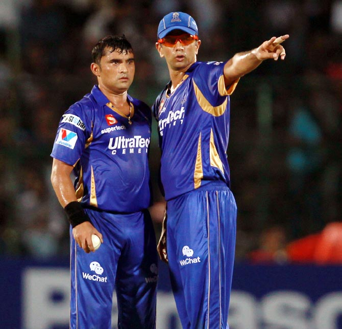 Rahul Dravid (right) speaks to Pravin Tambe