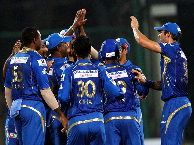 Mumbai Indians celebrate the wicket of Lendl Simmons