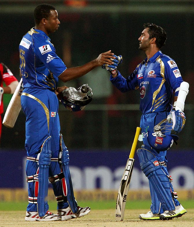Kieron Pollard (left) and Dinesh Karthik celebrate the win