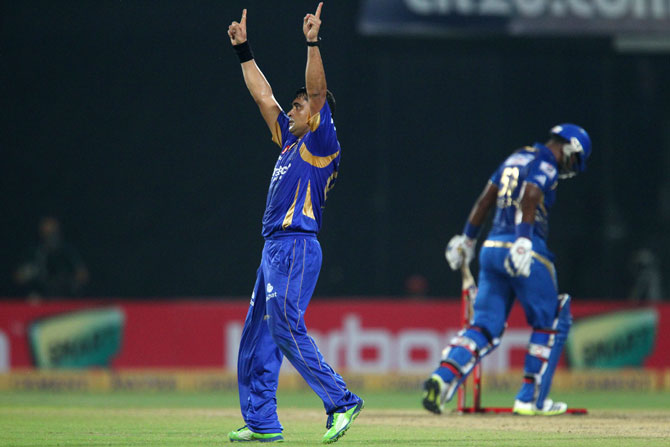 Pravin Tambe of Rajasthan Royals celebrates the wicket of Dwayne Smith of Mumbai Indians