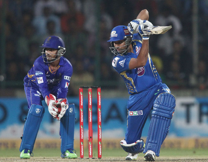 Mumbai Indians captain Rohit Sharma drives a delivery square