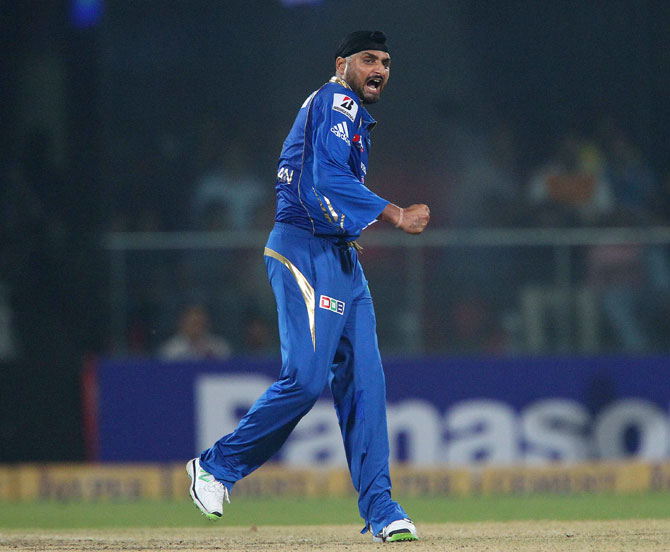 Harbhajan Singh of Mumbai Indians celebrates the wicket of Stuart Binny of Rajasthan Royals