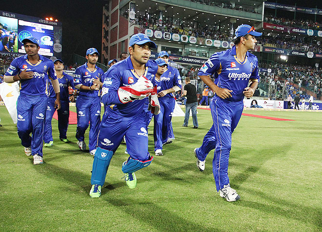 Rajasthan Royals captain Rahul Dravid leads his players out for the last time during the final of the Champions League T20 against Mumbai Indians on Sunday