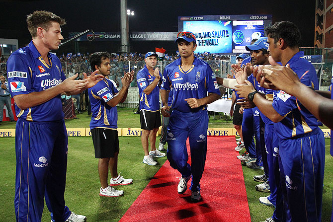 Rajasthan Royals captain Rahul Dravid walks through a Guard of Honour before the final of the Champions League T20 against Mumbai Indians on Sunday