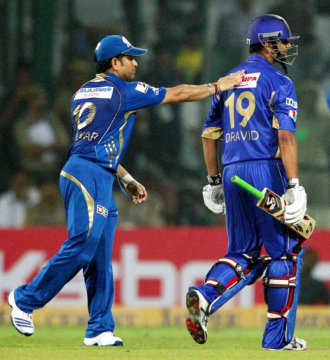 Sachin Tendulkar pats Rahul Dravid on the back after his dismissal in the Champions League T20 final