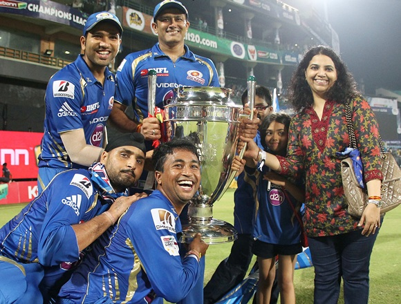 Mumbai Indians players celebrate with trophy after winning final