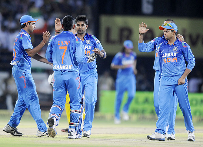 India players celebrate after a dismissal