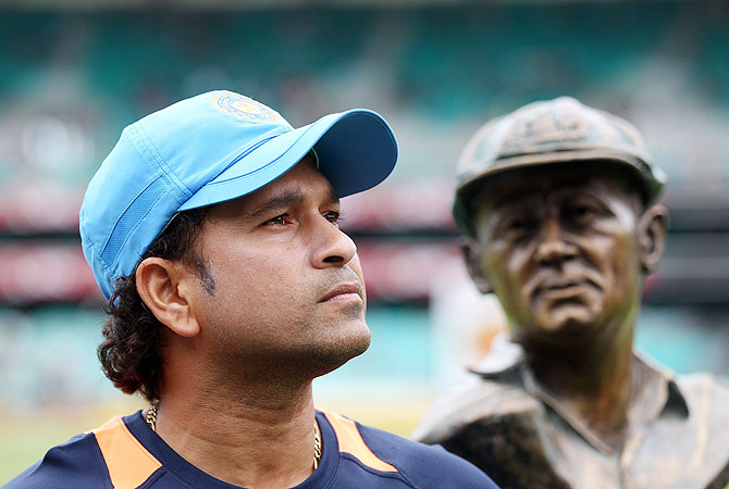 Sachin Tendulkar of India looks on with a bust of Sir Donald Bradman in the background