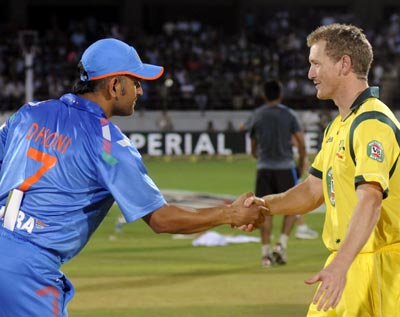 India captain Mahendra Singh Dhoni (left) with Australia captain George Bailey