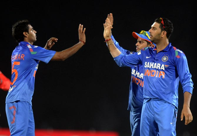 Yuvraj Singh (right) congratulates Bhuvneshwar Kumar (right)