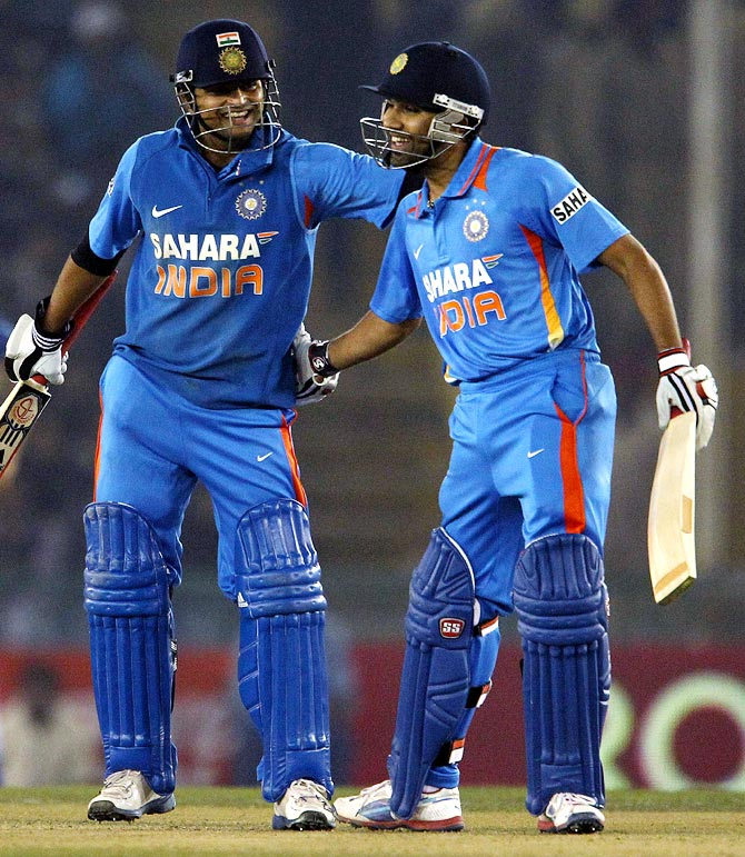 Rohit Sharma (right) with Suresh Raina