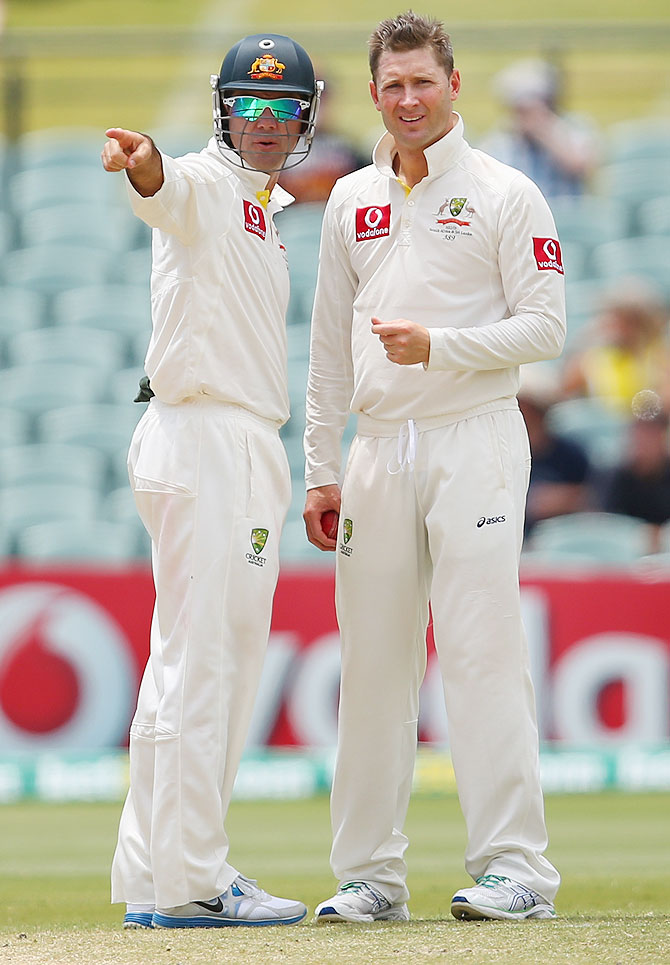 Ricky Ponting of Australia talks to captain Michael Clarke
