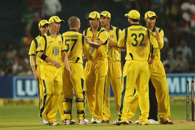 Australian team celebrates fall fo an Indian wicket