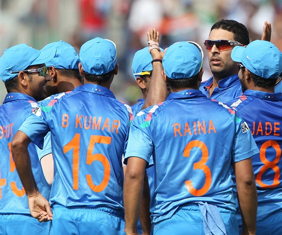Yuvraj Singh is congratulated by teammates