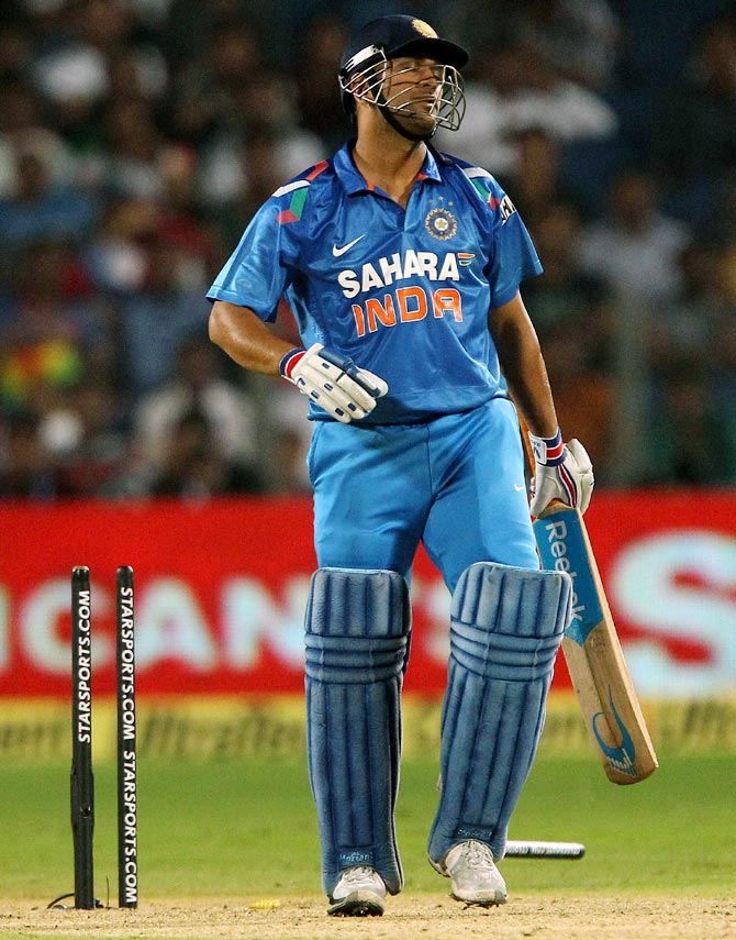 Mahendra Singh Dhoni reacts after his dismissal in the first ODI, in Pune.