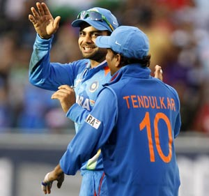 Virat Kohli (left) with Sachin Tendulkar