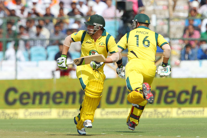 Aaron Finch and Phillip Hughes of Australia