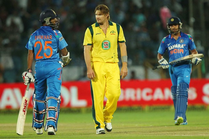 Shane Watson of Australia has something to say to Shikhar Dhawan of India after being hit for four