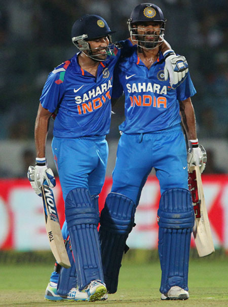 Rohit Sharma of India congratulates teammate Shikhar Dhawan on his fifty