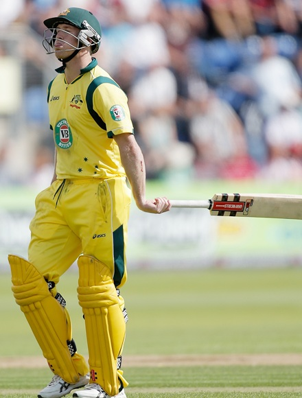 George Bailey of Australia walks off