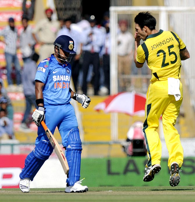 Mitchell Johnson celebrates after dismissing Suresh Raina
