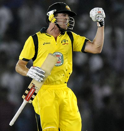 Australia's James Faulkner celebrates after winning the 3rd ODI in Mohali on Saturday
