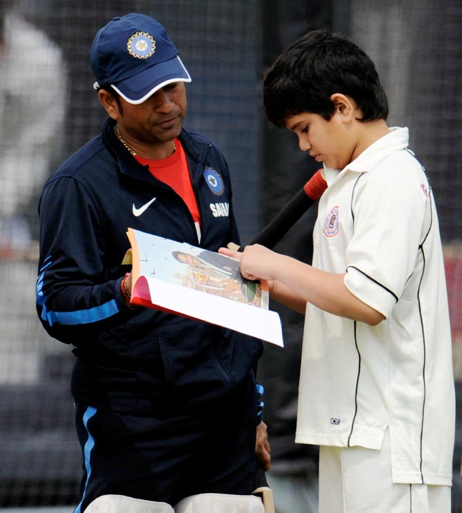 Sachin Tendulkar (left) with his son Arjun