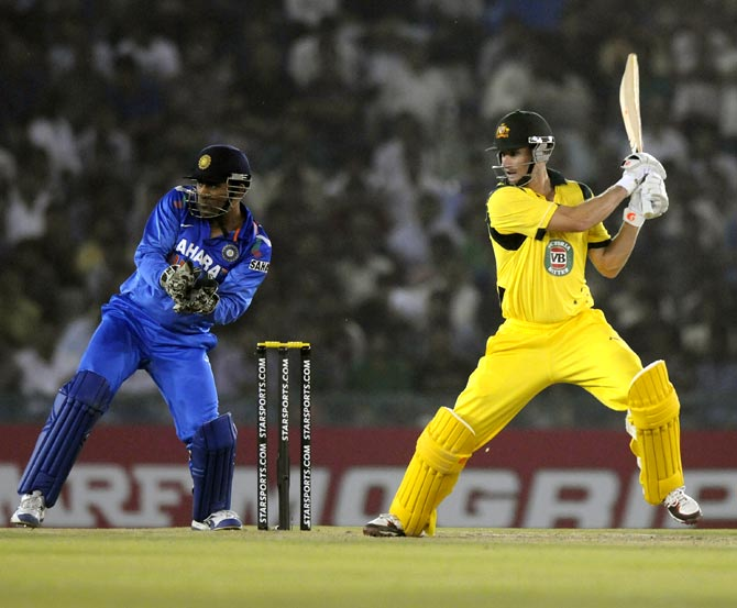 Adam Voges hits it past point as wicketkeeper Mahendra Singh Dhoni looks on