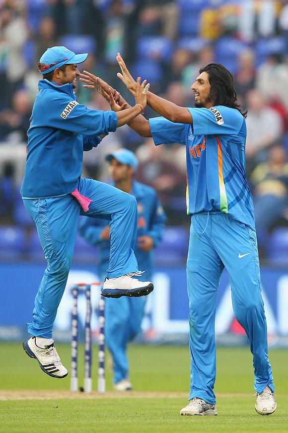 Ishant Sharma celebrates with Suresh Raina (left)