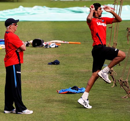 India's coach Duncan Fletcher with Ishant Sharma in the nets