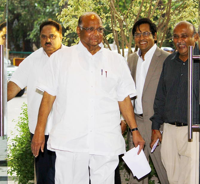MCA president Sharad Pawar (2nd left) with managing committee member Nadeem Menon (left), vice-president Dr Vijay Patil, (2nd right) and joint secretary Nitin Dalal in Mumbai.
