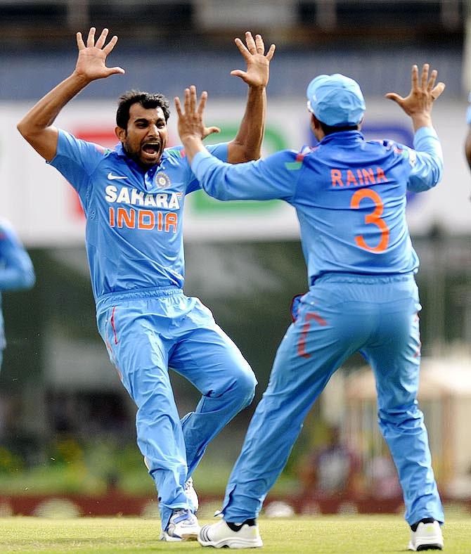 Shami Ahmed celebrates a wicket
