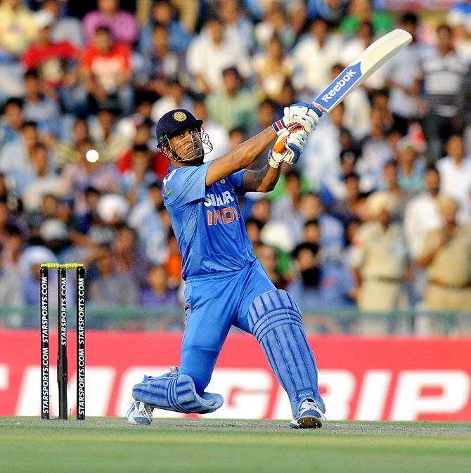 Mahendra Singh Dhoni hits a six