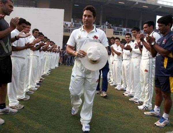 Sachin Tendulkar gets a guard honour from both teams as he enters the field on Day 1 of the Ranji Trophy match.