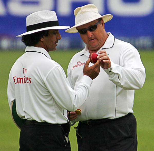 Umpires Asad Rauf (left) and Ian Howell check the ball during a match