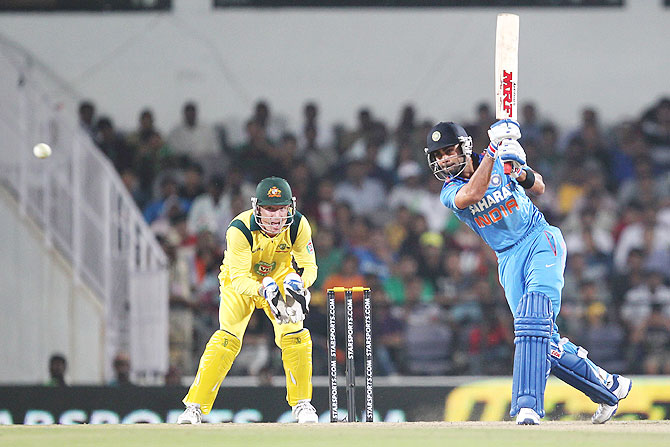 Virat Kohli hits a shot