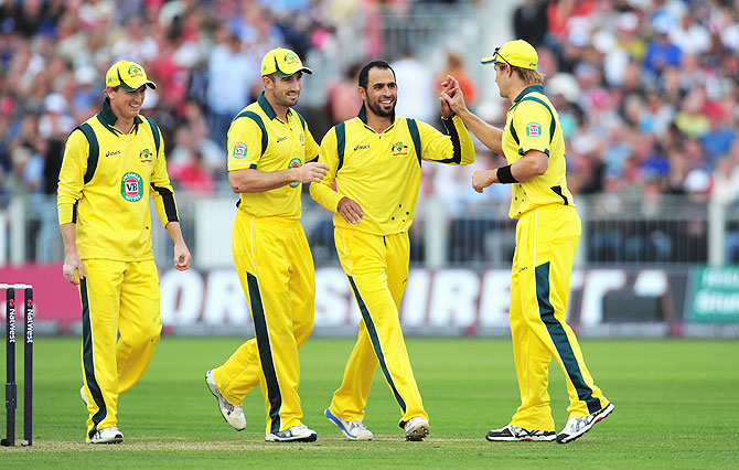 Australia bowler Fawad Ahmed (2nd from right) celebrates with teammates after picking a wicket