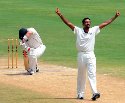 Dhawal Kulkarni celebrates the wicket of Neil Broom