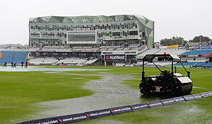 Puddles form on the outfield as rain delays the start of play at Headingley Carnegie Stadium on in Leeds, England, on Friday