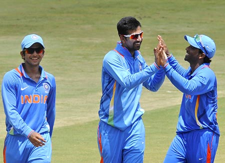 Ashok Menaria (centre) celebrates with team mates