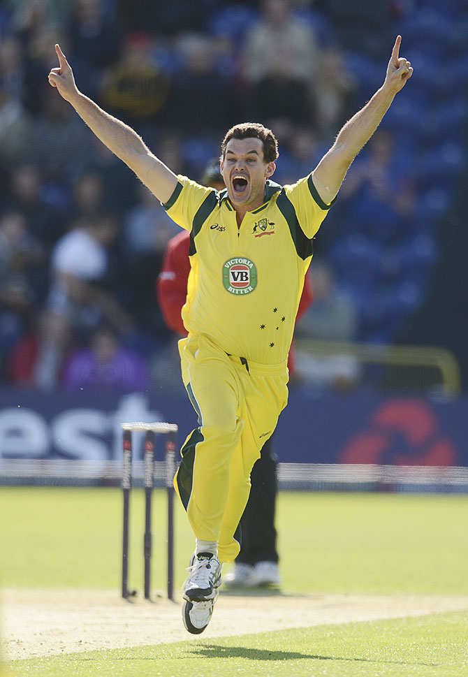 Australia's Clint McKay celebrates after achieving a hat-trick on Saturday