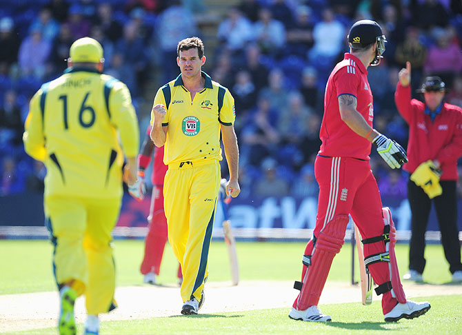 Australia bowler Clint Mckay (centre) celebrates after taking the first wicket of his hat trick by dismissing England batsman Kevin Pietersen on Saturday