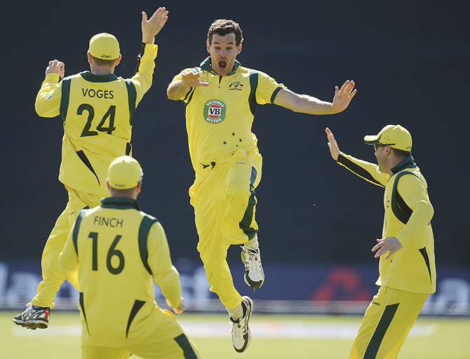 Australia's Clint McKay (2nd from right) celebrates with teammates after achieving a hat-trick after dismissing England's Joe Root on Saturday